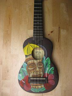 Ukulele with hand painted retro Tiki motif