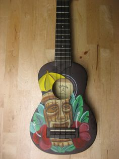 Ukulele with hand painted retro Tiki motif