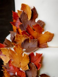 Hmmm...sugar cookie dough painted and shaped then attached to a fall wedding cake?