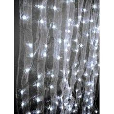 String lights behind sheer curtains