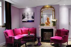 Such an amazing room with hot pink furniture and the light purple walls