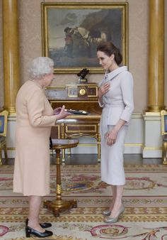 Actress Angelina Jolie is presented with the Insignia of an Honorary Dame Grand Cross of the Most Distinguished Order of St Michael and St George by Queen Elizabeth II in the 1844 Room on October 10, 2014 at Buckingham Palace, London. Jolie is receiving an honorary damehood (DCMG) for services to UK foreign policy and the campaign to end war zone sexual violence.