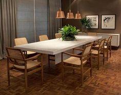 Inspiração: 10 salas de jantar com a poltrona Oscar, de Sergio Rodrigues