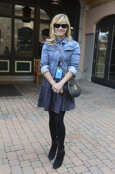 Fall dates can be tricky to dress for, so here's an outfit idea that's equal parts sexy and warm. Layer a jean jacket over a flouncy dress and snap the top two buttons for extra styling points. Tights, ankle boots, and a cross-body bag are the perfect accessories for an outdoor situation