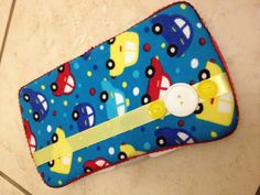 Cars embellished wipes case. $9.   By Fluff N' Stuff  https://m.facebook.com/groups/253106198097799?view=permalink=408161689258915_id=431549513586799_t=group_comment=m_notif&__user=635265332#!/FluffNStuffAlvaDiapersandAccessories?ref=m_notif_t=group_comment&__user=635265332