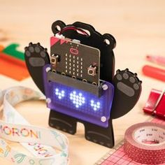 Build and code your own wearable bear badge with our scroll:bit micro:bit kit. Hang it around your neck and code it to be a name badge, fortune teller, or tilt-activated ghost. Arduino, Computer Board, Raspberry Pi 1, Bbc, Mini Arcade, Rgb Led, Coding For Kids, Name Badges, Mobile Phones