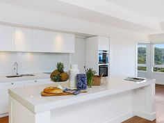 White kitchens will always hold a special place in our heart - Blizzard counters and spotless white cabinets keep to the aesthetic we know and love Design: Newport Beach House, Facade House, Kitchen Reno, White Cabinets, Raised Beds, Modern Interior, Layout Design, Home Kitchens, House Design
