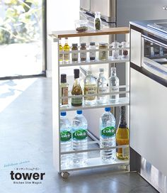 Keep your bathroom organized while saving space with the Rolling Bathroom Storage Tower. This storage tower can hold all of your bathroom necessities. Designed with 3 shelves to maximize space. Kitchen Storage Trolley, Rolling Storage Cart, Kitchen Organization, Kitchen Cart, Kitchen Storage Containers, Intelligent Design, Space Saving Furniture, Wooden Shelves, Bathroom Storage