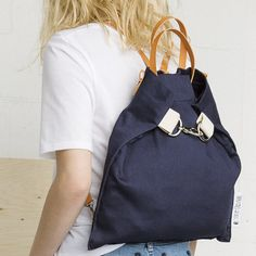 Of a sleek and contemporary style, this cute little bag is a very practical model, since it can be worn in two, and even in three ways; as a backpack, as a shoulder bag, or even as a hand bag. Very light, it has two interior pockets and a magnetic opening. Available in two fashionable colors.