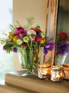 Burst of color. Ranunculi's are the gentler roses of the plant world. Stunning against these golden accessories.