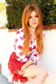 Katherine McNamara in strawberry lace miniskirt, white open-collared blouse w…