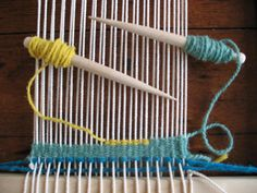 A (weft) yarn is then woven under and over the warp yarn using a tapestry bobbin.  Each row of weft yarn is pushed down with the point of the bobbin until the warp is completely covered to create a 'weft-faced' fabric.