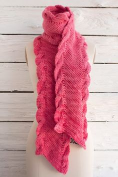 """So lovely! This pretty in pink scarf is knit on the bias (diagonally) and  edged with ribbed cables. It's another stunning free knitting pattern  designed by Lisa Myers and features kettle dyed Manos Maxima yarn.  Completed Scarf Measures: 9"""" across the bias x 72"""" long  You will need:      * 2 skeins Manos Maxima Yarn, shown in color Coral #2145     * Size US 10 needles     * Cable needle     * DOWNLOAD Biased Scarf Free Knitting Pattern  Happy knitting!"""
