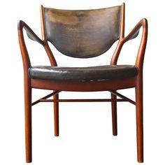 NV46 by Finn Juhl | From a unique collection of antique and modern armchairs at http://www.1stdibs.com/furniture/seating/armchairs/