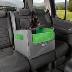 Skybox rear booster seat for dogs is a pet car seat that elevates dog to look out window while providing a safe car seat.