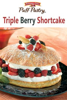 Puff Pastry Triple Berry Shortcake Recipe. As berries start to come back in season, layer those delicious little jewels with sweet orange-scented whipped cream and flaky puff pastry!