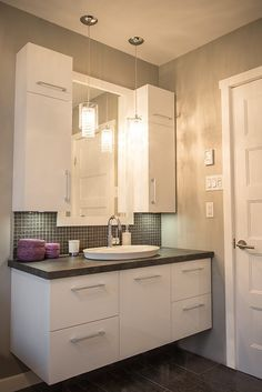 This bathroom is function over design. I like the extra storage with the wall cabinets.