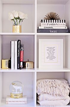perfect shelf: books, things filling spaces, colorful back, stuff leaning at the back, different layers & heights, single objects or odd numbers, textured objects (natural, throws, pillows), something shiny