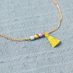 Golden Beaded Tassel Bracelet