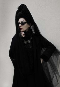 i've wanted to wear a mantilla since i was very young. that, the perma-shades and all-black-all-the-time make diane pernet a personal style icon.