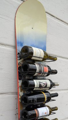 This wine rack holds ten bottles and is made from a repurposed snowboard. We use upcycled snowboards and fit them with corrosion-resistant hardware and fasteners. They ship with mounting hardware for either a wall or floor-mounted installation. This wine rack measures approximately 64L x 10W