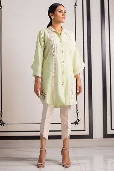 indian designer wear A front open karandi kurta, with embroidery and lace details. Pair yours with beautiful Raw silk pants with lace detailing for maximum impact. *Raw silk pants with lace detailing to be sold separately. Fancy Dress Design, Stylish Dress Designs, Stylish Dresses, Simple Dresses, Pakistani Fashion Party Wear, Pakistani Dresses Casual, Pakistani Dress Design, Kurta Designs Women, Kurti Designs Party Wear