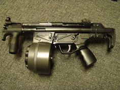 "Heckler & Koch MP5K with 100 round C-MAG magazine. Cyclic rates of 800 rounds/second. That's about 7.5 seconds of full auto 9x19mm madness.  Nicknamed the ""Room Broom."""