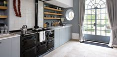 Sleek lines and a dramatic window complement this chic Aga cooker