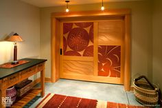Front and back views - Carved doors in a Pacific Northwest style by David Franklin. Wood Barn Door, Barn Door Hardware, Wood Doors, Wooden Sliding Doors, Double Sliding Doors, Pacific Northwest Style, Exterior Barn Doors, Carriage Doors, Barn Door Designs