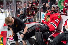 CHICAGO, IL - FEBRUARY 23: Goalie Corey Crawford #50 of the Chicago Blackhawks gets his skate adjusted prior to the game against the Arizona Coyotes at the United Center on February 23, 2017 in Chicago, Illinois. (Photo by Bill Smith/NHLI via Getty Images)