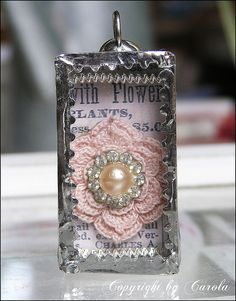 Shadow box soldered pendant with crocheted flower and rhinestone finding.