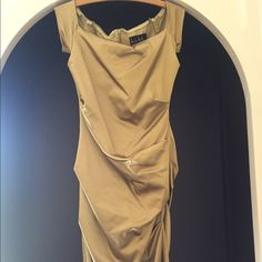 Nicole Miller size 8 gold bodycon cocktail dress. Brushed satin off the shoulder cap sleeve formal daytime or cocktail evening dress. Perfect with strappy heels. Photo included to more accurately show the color - it's a muted, mossy gold. Really classy. Worn once and dry cleaned. Nicole Miller Dresses Midi