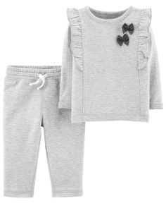 In a long-sleeve tee with 3D bows and coordinating pull-on pants, this set keeps her both cozy and cute.