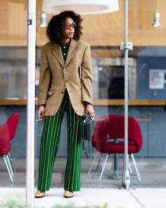 Mix and match patterns with pinstripe trousers and an oversized blazer. Top off the look with reflective sunglasses as seen on the NYFW street style scene.
