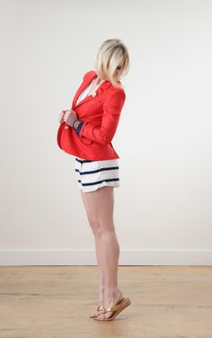 In true American fashion, Ashley goes all out with her navy striped white shorts & tailored red jacket, which she pairs with the classic Gwen Gold (one-inch) Wedge for a look that is star-spangled chic from head to toe.