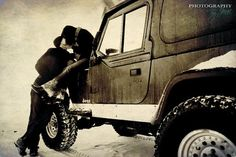 kissing on a snowy jeep - this seems like a picture we need to have of ourselves.