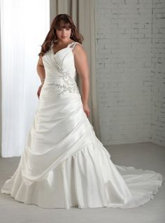 Beautiful plus size wedding dress with train design and v-neck. Delicate appliqué is embellished near the waist to add elegance and beauty for you. Back corset is also included. Free made-to-measurement service for any size. Available colors seen as in Color Options.