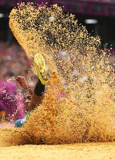 Sand spray from triple jump