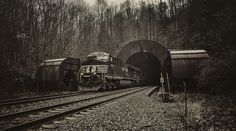 Elkhorn Tunnel, Maybeury, West Virginia.     The tunnel is 7,000 feet long and straight as an arrow.  In the days  of steam it was often hard for the train crews to breathe and there  was even a suffocation danger.  To solve that problem those large fans  were installed to blow the smoke ahead of the train.  They were  retired in place once steam was no longer used.