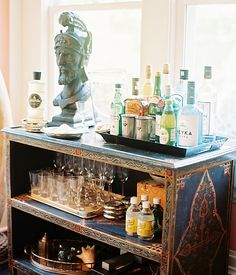 Turn a bookcase into your at home bar for a serious conversation starter!