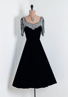 1940s dress via Timeless Vixen Vintage/ I have a simple black dress that is just begging for this top....
