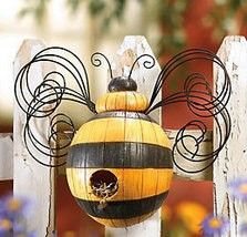 Garden Bumblebee Birdhouse  Has a welcoming perch on the front and an opening on the bottom for easy cleaning. It is crafted of hand-painted polyresin with a metal wings