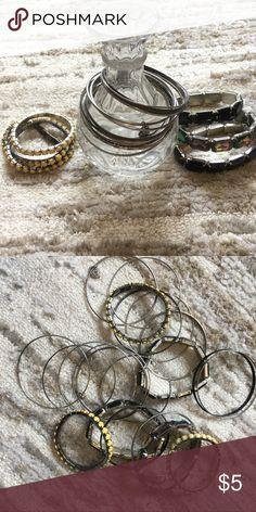 Bundle of 20 bangle and stretch bracelets! Costume jewelry. Bangle silver & black bracelets. Yellow, Black & iridescent stones on a stretch band. Jewelry Bracelets