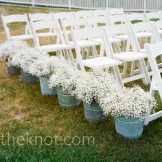 Baby's Breath in Galvanized buckets Wedding Ceremony Decor. I normally hate baby's breath in arrangements but alone like this is gorgeous.