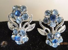 Vintage Blue White Rhinestone Crystal Silver Floral Clip Earrings signed Coro #Coro #cliphuggiedrop