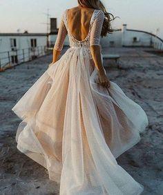 dreamy floaty long sleeved wedding dress
