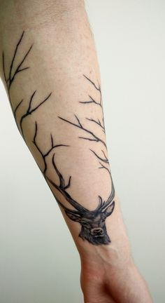 Deer buck tattoo, branches as antlers. Done by Roni Airling at Blue Dragon Tattoo, Helsinki, Finland