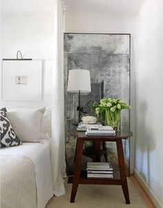 I love the idea of a large piece of framed art sitting on the floor leaning against a wall