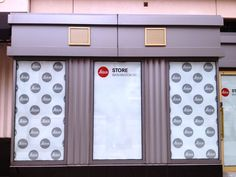 How fun is a repeated pattern of logo(s)? Could this be the curtains installed in place of the blinds?