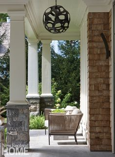 The home's traditional front portico offers a sheltered spot to relax. Architectural, interior, and landscape design: SBP Homes. Outdoor Rooms, Outdoor Living, Cedar Shingle Siding, Oak Framed Extensions, Porch Pillars, Veranda Magazine, Riverside House, Porch Wall, Column Design